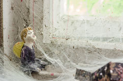 Angel figure and cobwebs. In old house Stock Photography