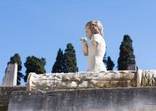 Angel figure statue on the Marco Nonio Balbo terrace in Parco Archeologico di Ercolano. Pictured is an Angel figure statue on the Marco Nonio Balbo terrace in in Royalty Free Stock Photos