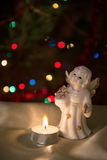 Angel figurine and candle. Royalty Free Stock Image