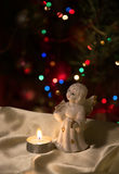 Angel figurine and candle Royalty Free Stock Photos