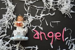 Angel Figurine, Easter Holiday Composition in White, Black, Pink and Blue Stock Photo
