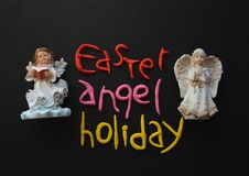 Angel Figurine, Easter Holiday Composition in White, Black, Pink, Red and Yellow Royalty Free Stock Photo
