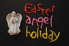 Angel Figurine, Easter  Holiday Composition in White, Black, Pink, Red and Yellow Royalty Free Stock Photography
