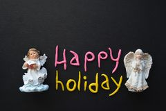 Angel Figurine,  Holiday Composition in White, Black, Pink, and Yellow Stock Images