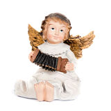 Angel figurine playing accordion. On white Stock Images