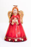 Angel figurine praying and smiling. Red ceramic angel figure praying and smiling on a white background Royalty Free Stock Image