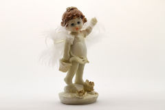 Angel figurine on white background. Statuette of an angel on white background Royalty Free Stock Images