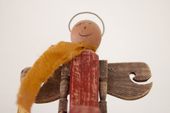 Angel figurine. Wooden toy angel with a yellow scarf Royalty Free Stock Image