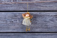 Angel figurine on wooden wall Royalty Free Stock Photos