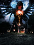 Angel of fire. Night scene with old house and angel holding fireball Royalty Free Stock Photos