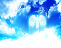 Angel flying. In the clouds Stock Photo