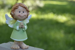 Angel with folded hands. Angel in green dress, angel with folded hands, angel smiles Royalty Free Stock Photos