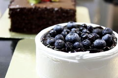 Cake decorated with fresh blueberries and cream Stock Photography