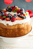 Angel food cake with whipped cream and berries Royalty Free Stock Photo