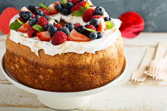 Angel food cake with whipped cream and berries Royalty Free Stock Images