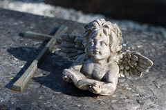 Angel in front of a cross - reading a book Stock Photos