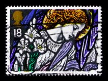 `Angel Gabriel`, St James`s, Pangbourne, Christmas 1992 - Stained-glass Windows serie, circa 1992. MOSCOW, RUSSIA - OCTOBER 3, 2017: A stamp printed in Great royalty free stock images