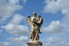 Angel with Garment and Dice from Ponte Sant'Angelo in Rome, with Stock Photos