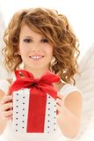 Angel with gift. Picture of happy teenage angel girl with gift over white Stock Photos