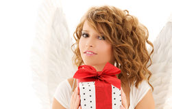 Angel with gift. Picture of happy teenage angel girl with gift over white Stock Photography