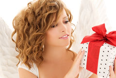 Angel with gift. Picture of happy teenage angel girl with gift over white Royalty Free Stock Image
