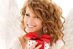 Angel with gift Stock Photos