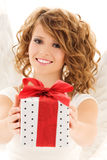 Angel with gift. Picture of happy teenage angel girl with gift over white Stock Image
