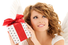 Angel with gift. Picture of happy teenage angel girl with gift over white Royalty Free Stock Photography