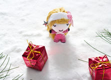 Angel and gift on snow, doll hand made concept. Angel and gift on snow, doll hand made style Stock Photos