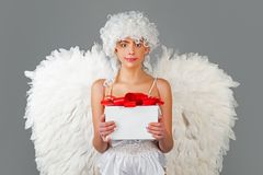 Angel with gift. Valentines cupid. Valentine`s Day: Gift, Romantic and Date. Romantic Gifts and Valentines Gift Ideas. Angel with gift. Valentines cupid royalty free stock photos