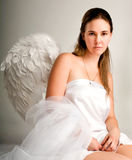 Angel girl. Beautiful girl in the image of an angel sitting on a chair Stock Photography