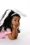 Angel girl. Cute little girl dressed like and angel making a pouty face stock photo
