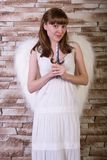 Angel girl on brick wall background Royalty Free Stock Images
