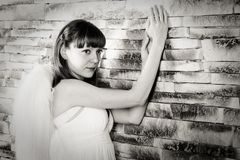 Angel girl on brick wall background Stock Image