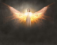Angel girl flying high. Attractive woman with angel wings on sky background royalty free stock image