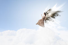 Angel girl flying high. Attractive woman with angel wings on sky background stock images