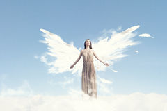 Angel girl flying high Royalty Free Stock Image