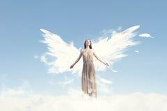 Angel girl flying high Royalty Free Stock Image