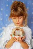 Angel girl holding christmas ball in hand Royalty Free Stock Photo