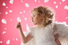 Angel girl holding a feather Royalty Free Stock Photography