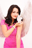 Angel girl holding an statue Stock Photography