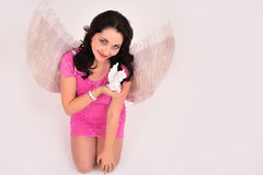 Angel girl holding an statue Royalty Free Stock Photo