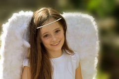 Angel girl. Portrait of a teenage girl with angel wings Royalty Free Stock Photos