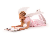 Angel girl studies Stock Photography