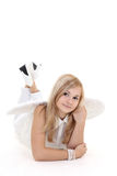 Angel girl in white lying Stock Photography