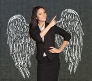 Angel girl with wings painted on the wall Stock Photos