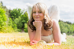 Angel with glass ball II. A young woman as an angel with a glass ball royalty free stock image