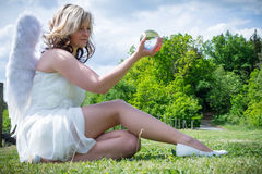 Angel with glass ball Royalty Free Stock Image