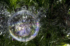 Angel glass Christmas tree bauble decoration. Angel glass Christmas tree bauble hanging from a tree stock photography