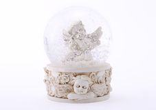 Angel in glass sphere. Angel and snow in glass sphere royalty free stock images